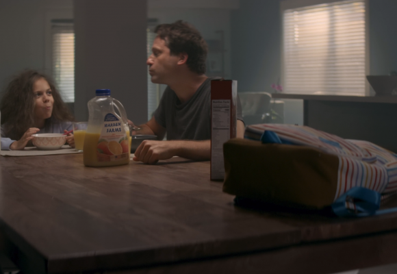 father and daughter having breakfast cereal